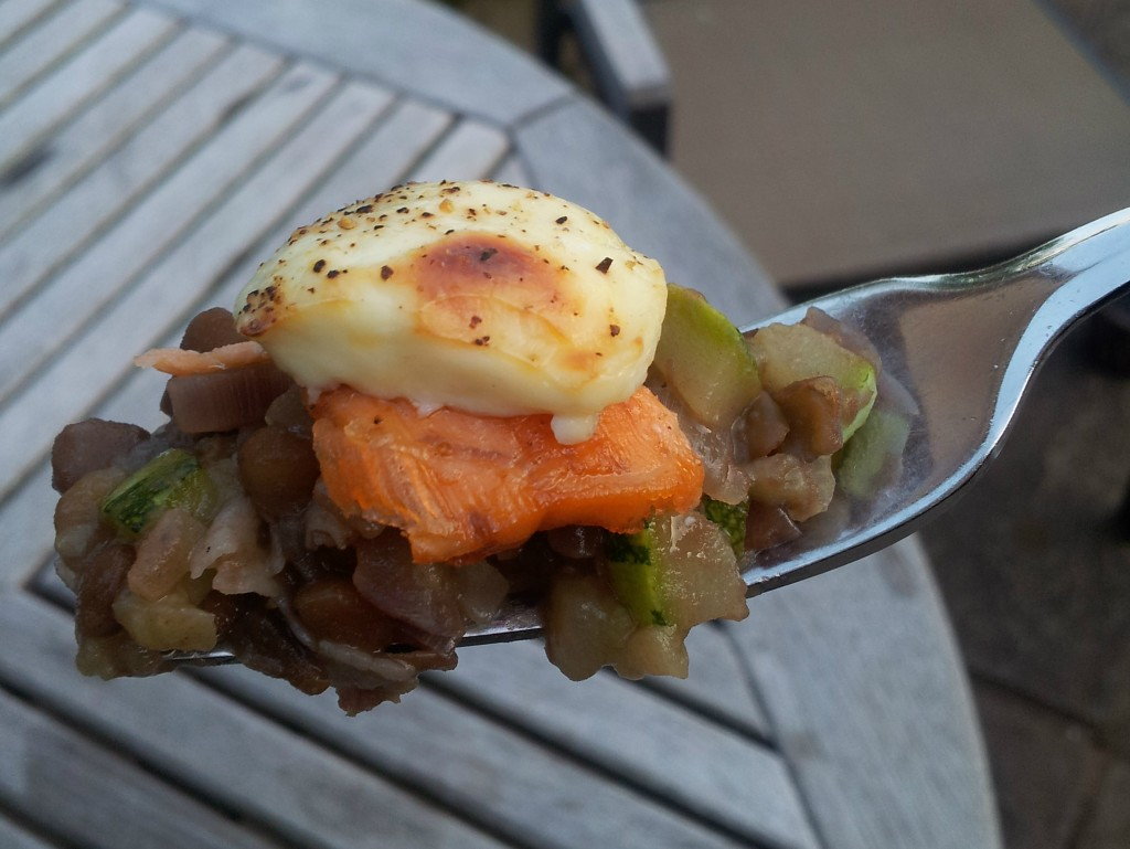 salmon and lentils on a fork