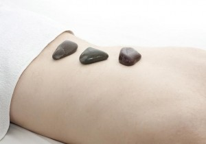 back massage with hot stones